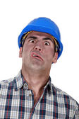 Portrait of grimacing worker — Stock Photo