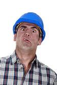 Portrait of grimacing worker — Stock Photo