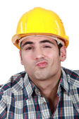 Craftsman grimacing — Stock Photo