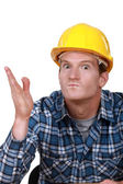 Tradesman looking ready to hit somebody — Stock Photo
