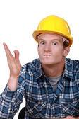 Tradesman looking ready to hit somebody — Stock Photo