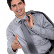Young businessman stretching out his hand to shake hands — Stock Photo #16342361
