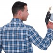 Stock Photo: Mholding spray gun