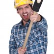 An angry construction worker with a sledgehammer. — Stock Photo