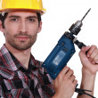 Photo: Tradesman holding an electric screwdriver