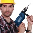 Tradesman holding an electric screwdriver — Stock Photo