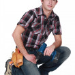 Young tradesman holding a rechargeable screwdriver — ストック写真