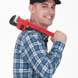 Stock Photo: Cheerful mwith adjustable wrench