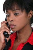 African woman making telephone call — Stock Photo