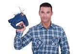 Carpenter holding sander machine — Stock Photo