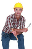 Carpenter with a hammer and chisel — Stock Photo