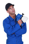 Workman in jumpsuit looking upwards — Stock Photo