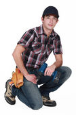 Young tradesman holding a rechargeable screwdriver — Stock Photo
