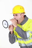 Worker with megaphone — Stock Photo