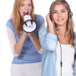 Girl listening music while he friends is singing through a megaphone — Stock Photo