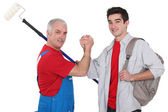 Experienced tradesman with new apprentice — Stock Photo