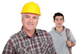 Mature craftsman with apprentice — Stock Photo
