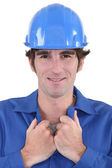 Craftsman wearing blue overalls — Stock Photo