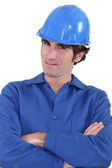 A handyman with his arms crossed. — Stock Photo