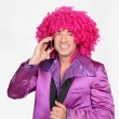 Stock Photo: Min seventies disco costume and silly wig