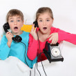 Brother and sister using old telephone — Stock Photo #16374363