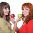 Two women holding apples — Foto Stock
