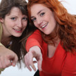 Two women pointing — Stock Photo #16376947