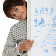 Young child standing behind his drawing — Stock Photo #16379079