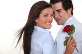 Man offering rose to woman — Stock Photo