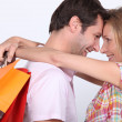 Stock Photo: Cuddle with shopping bags