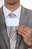 Executive with a blank business card — Stock Photo