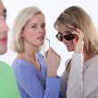 Women checking out a young man — Stock Photo