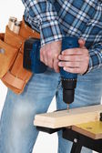 Man using an electrical screwdriver — Stock Photo