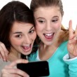 Two girls taking picture of themselves — Stock Photo