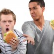 Friends eating hamburgers and watching football game — Stock Photo #16411515