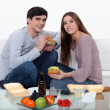Stock Photo: Couple eating fast food