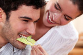 A couple sharing food. — Stock Photo