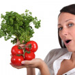 Young woman holding fresh tomatoes — Stock Photo #16433693