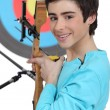 Stock Photo: Boy practicing archery