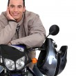 Man with his motorbike — Stock Photo