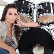 Sultry female drummer — Stock Photo #16442373