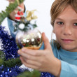 Stock Photo: Kid decorating Christmas tree
