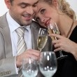 Stock Photo: Formal couple toasting their anniversary