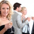 Group of with drink in hand — Stock Photo #16449945