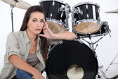 Sultry female drummer — Stock Photo