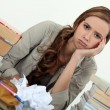 Foto Stock: Female student fed up with studying