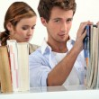 Couple in a library — Stock Photo #16454041