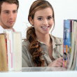 Couple in a library — Stock Photo #16454081