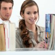 Couple in a library — Stock Photo