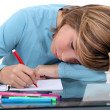 Tired child doing homework — Stock Photo #16454743